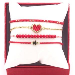 Set pulseras rojo oro